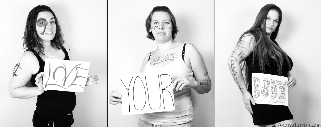 "Three women holding signs that read ""Love your body'"