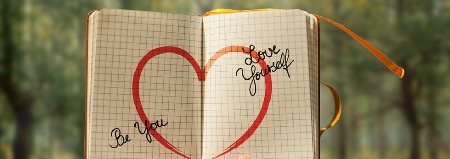 A heart drawn on a notebook with the text 'Be you...love yourself'