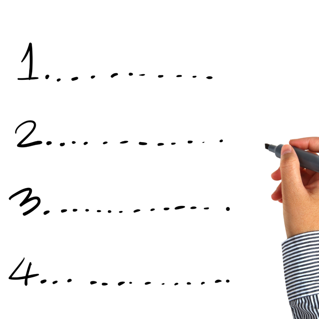 Picture of a hand holding a marker, next to a numbered list from 1-4, with dashed lines in front of each number.