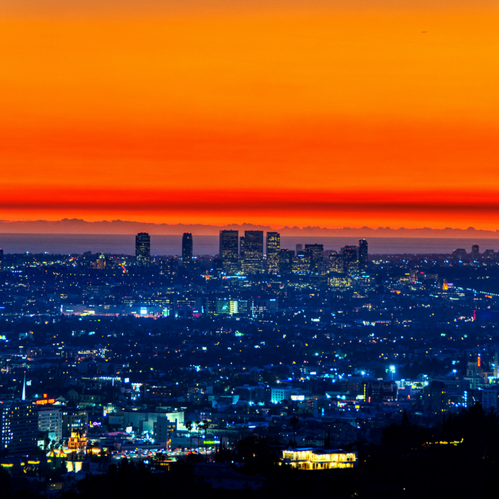 Sunset in Los Angeles, showing lit up buildings and roads