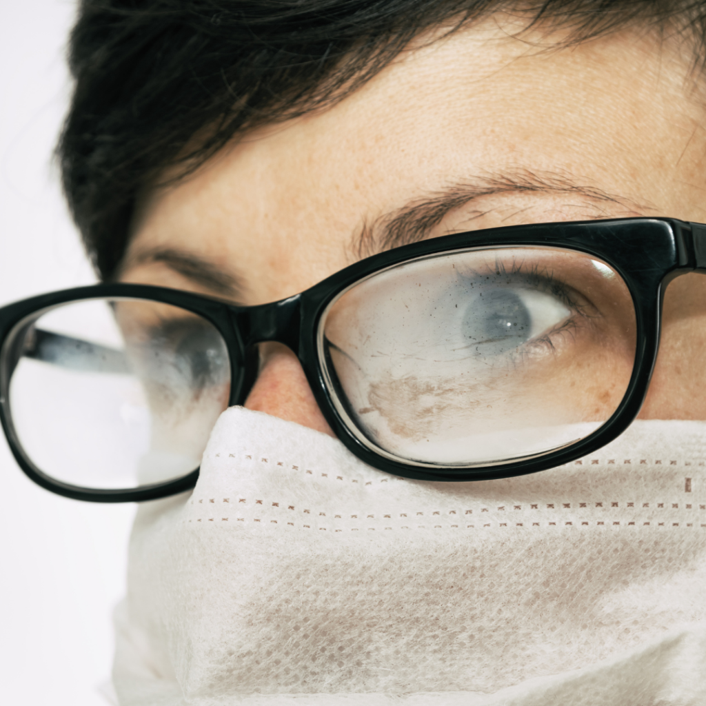 Person wearing foggy glasses and a mask