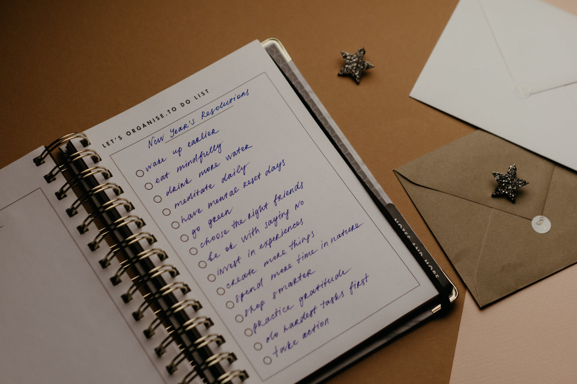 List of New Year resolutions written in a notebook